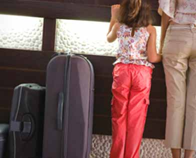mother, daughter and luggage