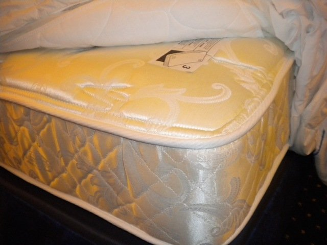Mattress with sheets pulled back